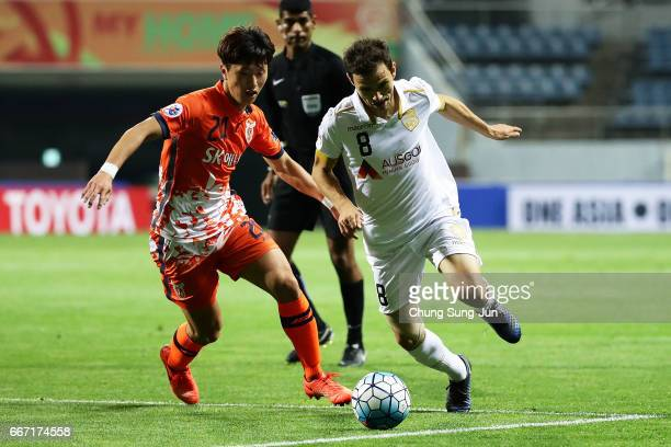 Isaias Sanchez of Adelaide United competes for the ball with Moon SangYun of Jeju United FC during the AFC Champions League Group H match between...