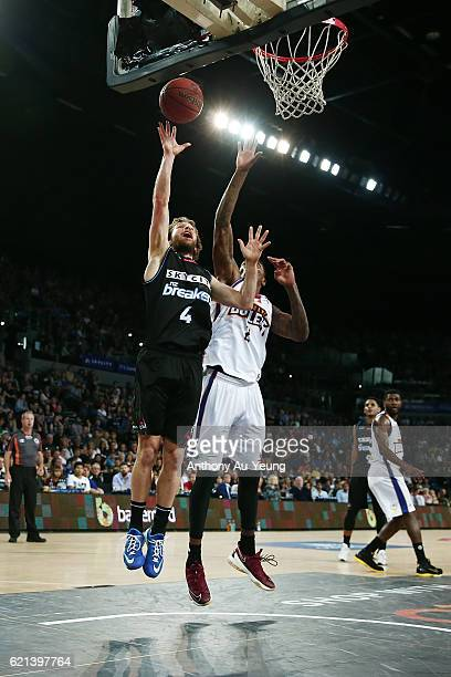 Isaih Tueta of New Zealand puts up a shot against Torrey Craig of Brisbane during the round five NBL match between the New Zealand Breakers and the...