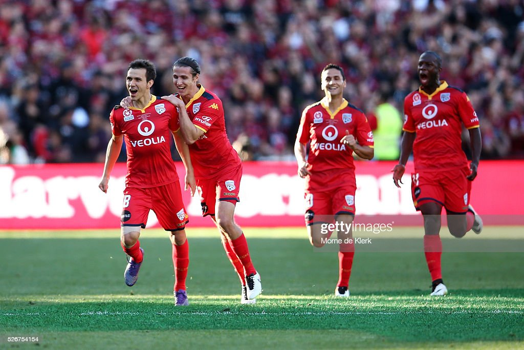 Isais (L) of Adelaide United celebrate with teammates after scoring a goal during the 2015/16 A-League Grand Final match between Adelaide United and the Western Sydney Wanderers at the Adelaide Oval on May 1, 2016 in Adelaide, Australia.