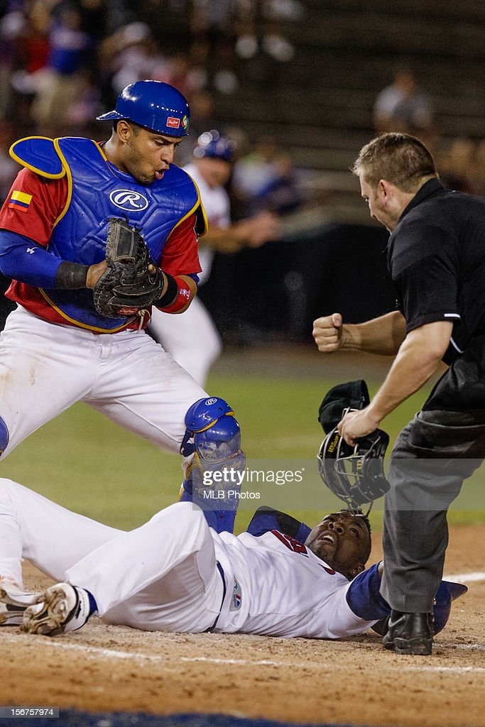 Isaisas Velasquez #7 of Team Panama is tagged out by Jhonatan Solano #23 of Team Colombia at home plate in the top of the sixth inning during Game 5 of the Qualifying Round of the World Baseball Classic between Team Panama Team Colombia at Rod Carew National Stadium on Sunday, November 18, 2012 in Panama City, Panama.