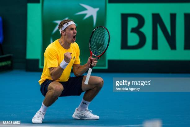 Isak Arvidsson of Sweden celebrates his victory after the second round single match against Mohamed Aziz Dougaz of Tunisia of the Europe and Africa...