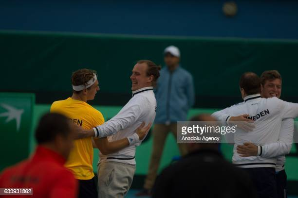 Isak Arvidsson of Sweden celebrates his victory with his friends after the second round single match against Mohamed Aziz Dougaz of Tunisia of the...