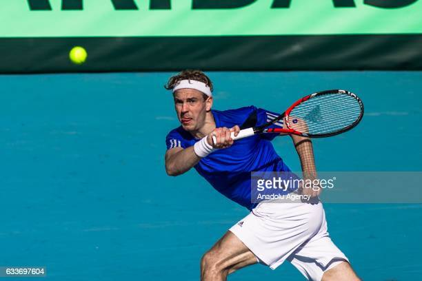 Isak Arvidsson of Sweden returns the ball to Malek Jaziri of Tunisia during their second round doubles match of the Europe and Africa Zone at El...