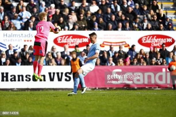 Isak Pettersson of Halmstad BK saves the ball from Markus Rosenberg during the Allsvenskan match between Halmstad BK and Malmo FF at Orjans Vall on...