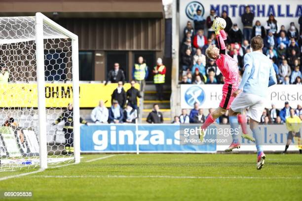 Isak Pettersson saves a shot during the Allsvenskan match between Halmstad BK and Malmo FF at Orjans Vall on April 16 2017 in Halmstad Sweden