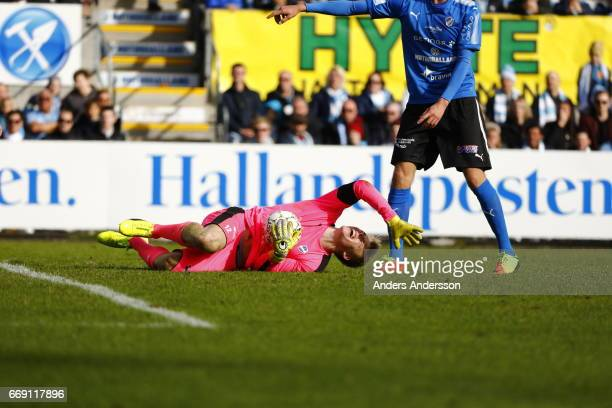 Isak Pettersson screams in pain after colliding with a Malmo player during the Allsvenskan match between Halmstad BK and Malmo FF at Orjans Vall on...