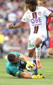Isaka Cernak of the Glory attempts to shoot the ball past Jets goalkeeper Mark Birighitti during the round 13 ALeague match between the Newcastle...