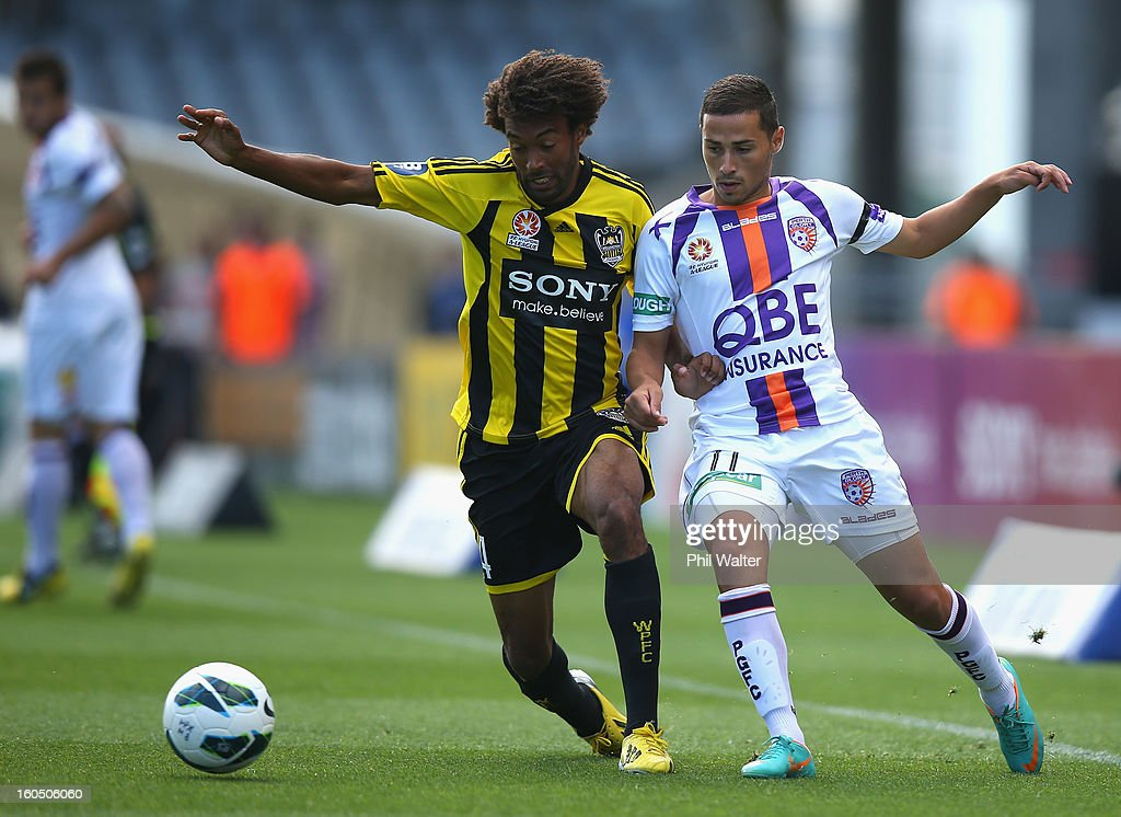 Isaka Cernak of Wellington (L) and Adrian Zahra of Perth (R) compete for the ball during the round 19 A-League match between the Wellington Phoenix and the Perth Glory at Eden Park on February 2, 2013 in Auckland, New Zealand.
