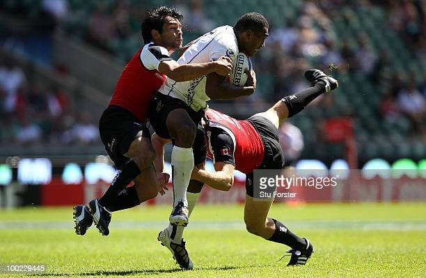 Isake Katonibau of Fiji is tackled by Philip Mack of Canada during the Pool C game between Somoa and United States day one of the IRB London Sevens...