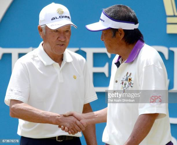 Isao Aoki and Masashi Ozaki shake hands prior to the first round of the Crowns at Nagoya Golf Club Wago Course on April 27 2017 in Togo Aichi Japan