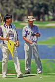 Isao Aoki reads a putt during the PGA Senior Championship Florida 1996