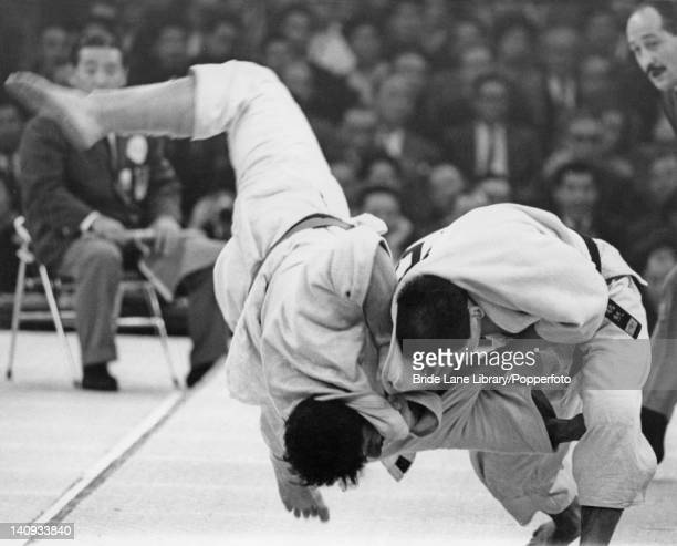 Isao Inokuma of Japan and Anzor K'ik'nadze of the USSR in action during the Men's Heavyweight Judo competition at the Olympic Games Nippon Budokan...