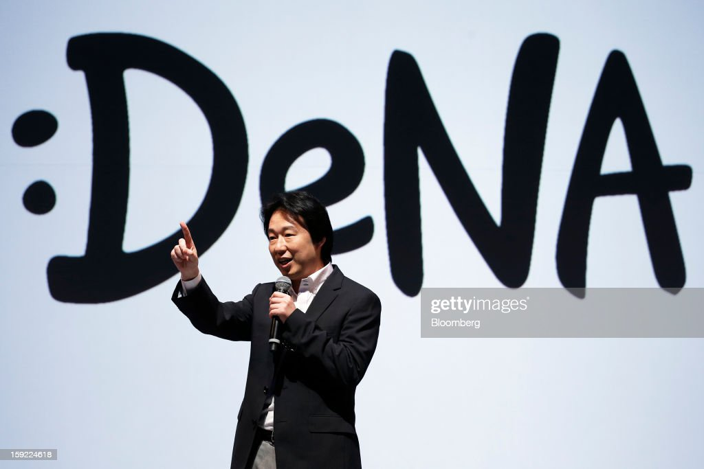 Isao Moriyasu, president of DeNA Co., speaks as he unveils the company's new logo during a news conference in Tokyo, Japan, on Thursday, Jan. 10, 2013. DeNA will offer music services for iOS and Android platforms within this fiscal year, according to a statement today. Photographer: Kiyoshi Ota/Bloomberg via Getty Images