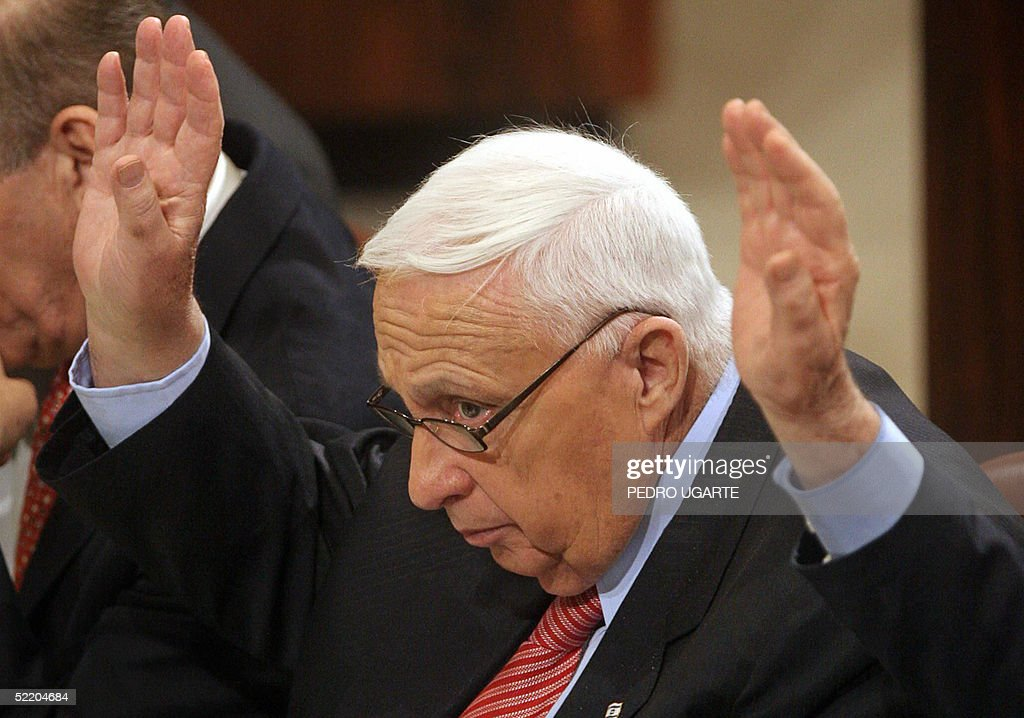 Isaraeli Prime Minister Ariel Sharon raises his hand during the process of voting for the aproval of the compensation bill for the settlers who will...