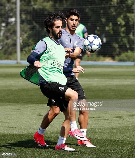 Isco Alarcon and Marco Asensio of Real Madrid warm up during a training session at Valdebebas training ground on May 9 2017 in Madrid Spain