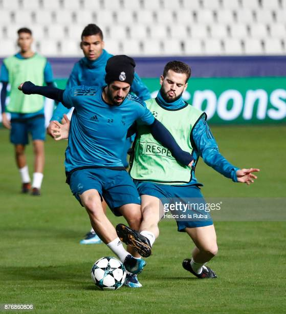 Isco Alarcon and Nacho Fernandez of Real Madrid warm up during the UEFA Champions League group H match between APOEL Nikosia and Real Madrid at GSP...