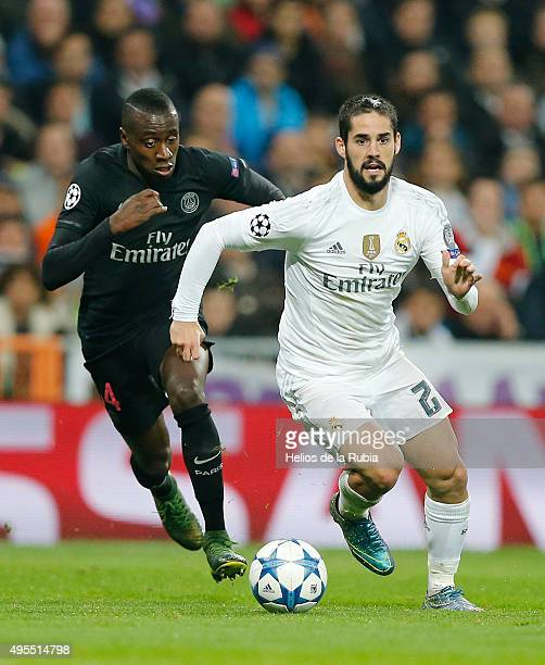 Isco Alarcon of Real Madrid and Blaise Matuidi of PSG compete for the ball during the UEFA Champions League Group A match between Real Madrid and...