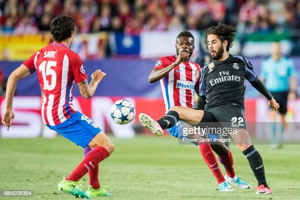 Isco Alarcon of Real Madrid battles for the ball with Thomas Teye Partey of Atletico de Madrid during their 201617 UEFA Champions League Semifinals...