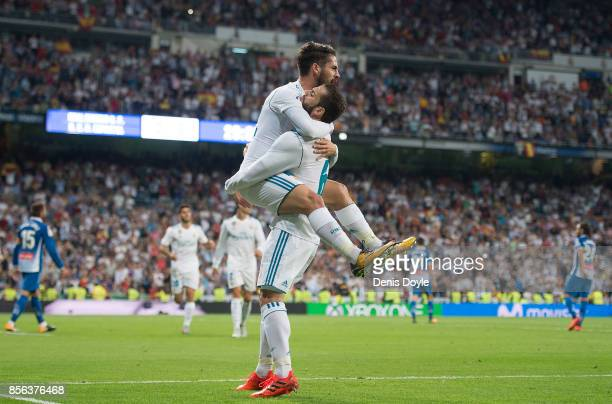 Isco Alarcon of Real Madrid CF celebrates with Nacho after scoring his teamÕs opening goal during the La Liga match between Real Madrid and Espanyol...