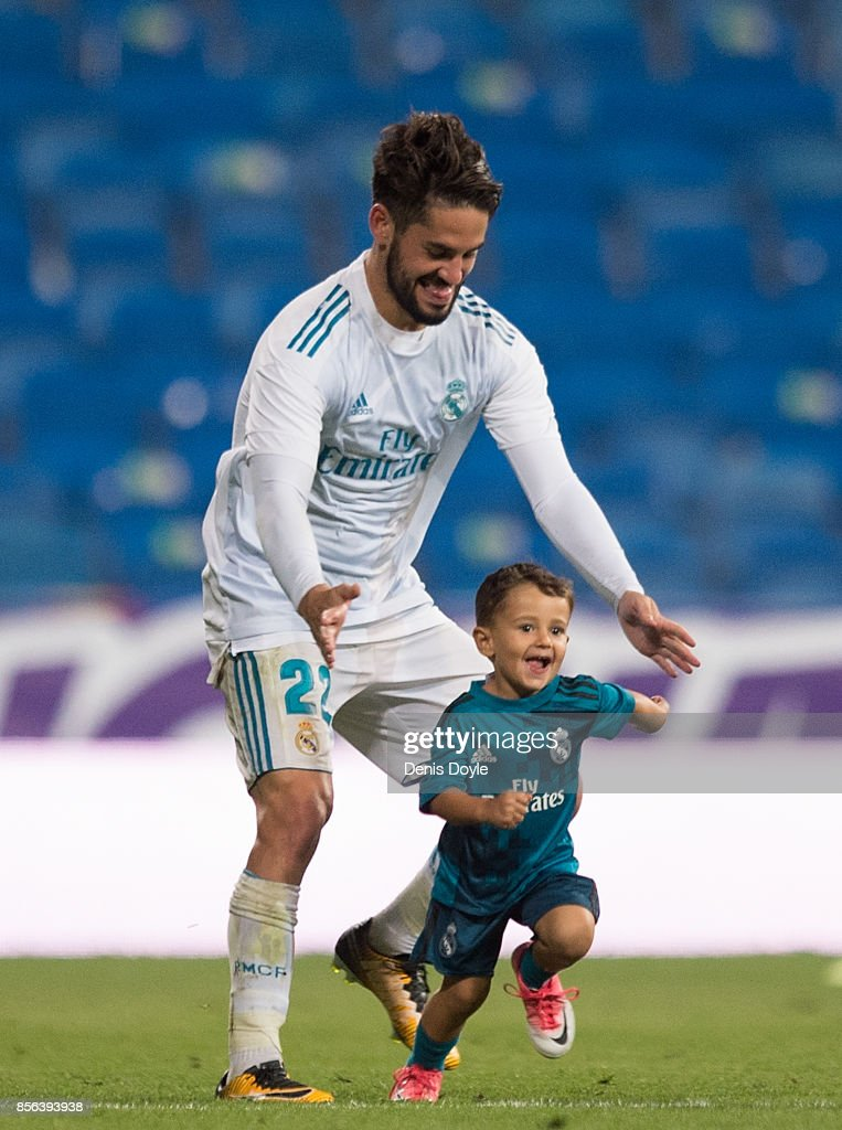 Isco Alarcon of Real Madrid CF plays with his son Francisco after the La Liga match between Real Madrid and Espanyol at Estadio Santiago Bernabeu on October 1, 2017 in Madrid, Spain.