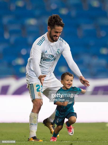 Isco Alarcon of Real Madrid CF plays with his son Francisco after the La Liga match between Real Madrid and Espanyol at Estadio Santiago Bernabeu on...