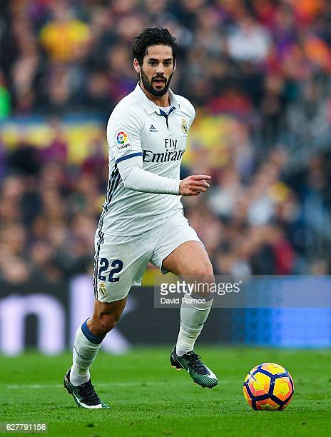Isco Alarcon of Real Madrid CF runs with the ball during the La Liga match between FC Barcelona and Real Madrid CF at Camp Nou stadium on December 3...