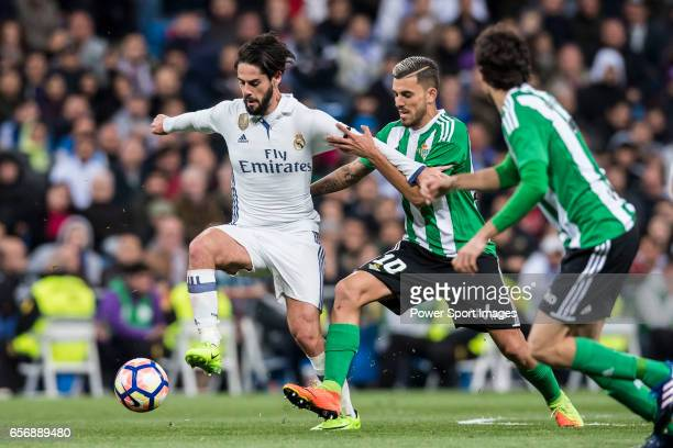 Isco Alarcon of Real Madrid competes for the ball with Daniel Ceballos Fernandez Dani Ceballos of Real Betis during their La Liga match between Real...