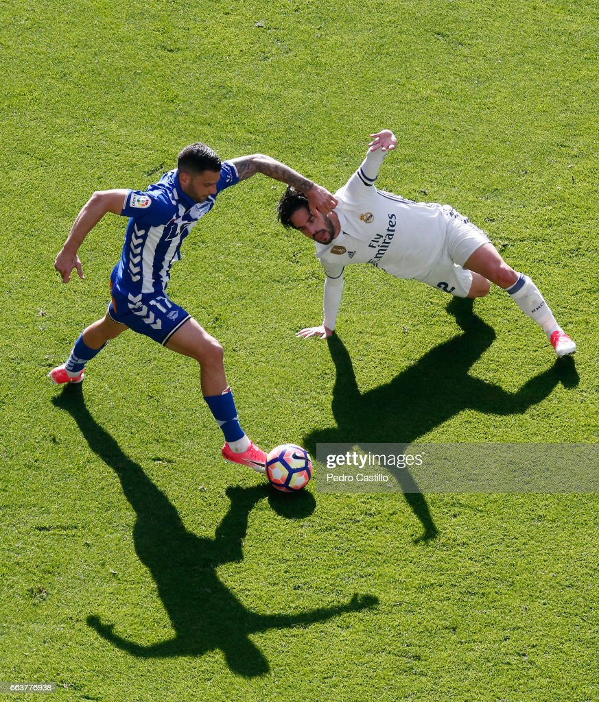 Isco Alarcon of Real Madrid duels for the ball with Edgar Mendez of Deportivo Alaves during the La Liga match between Real Madrid and Deportivo Alaves at Estadio Santiago Bernabeu on April 2, 2017 in Madrid, Spain.