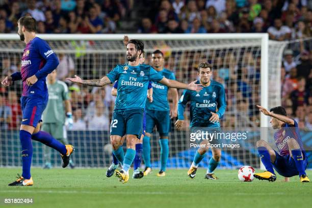 Isco Alarcon of Real Madrid gestures after trips up with Sergio Busquets of FC Barcelona during the Supercopa de Espana Final 1st Leg match between...