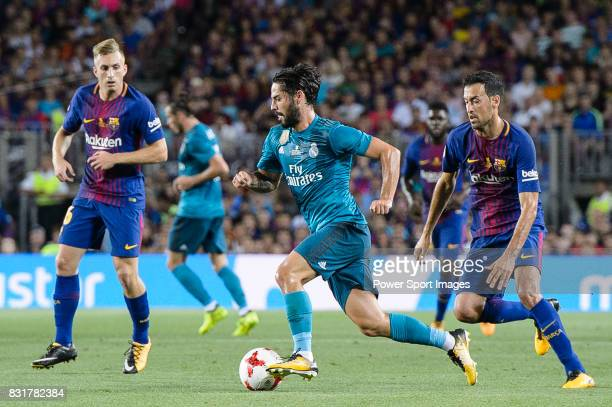 Isco Alarcon of Real Madrid in action against Sergio Busquets of FC Barcelona during the Supercopa de Espana Final 1st Leg match between FC Barcelona...
