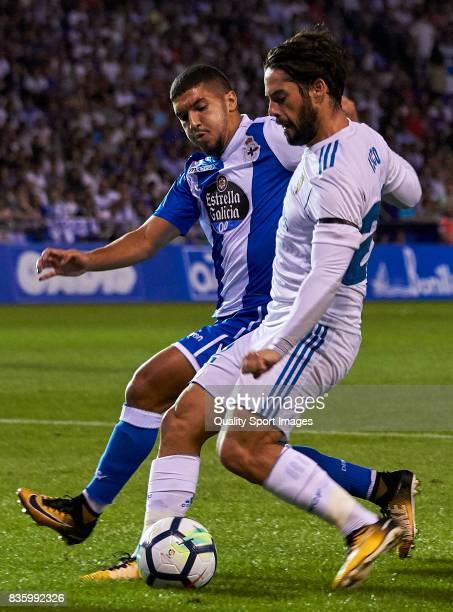 Isco Alarcon of Real Madrid is challenged by Zakaria Bakkali of Deportivo de La Coruna during the La Liga match between Deportivo La Coruna and Real...