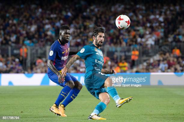 Isco Alarcon of Real Madrid plays against Samuel Umtiti of FC Barcelona during the Supercopa de Espana Final 1st Leg match between FC Barcelona and...