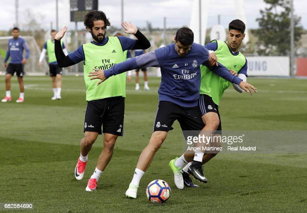 Isco Alvaro Morata and Marco Asensio of Real Madrid in action during a training session at Valdebebas training ground on May 13 2017 in Madrid Spain