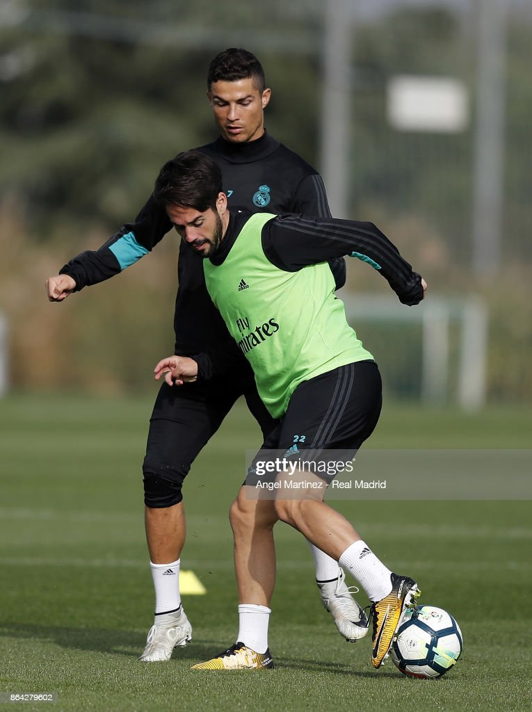 Isco (R) and Cristiano Ronaldo of Real Madrid in action during a training session at Valdebebas training ground on October 21, 2017 in Madrid, Spain.