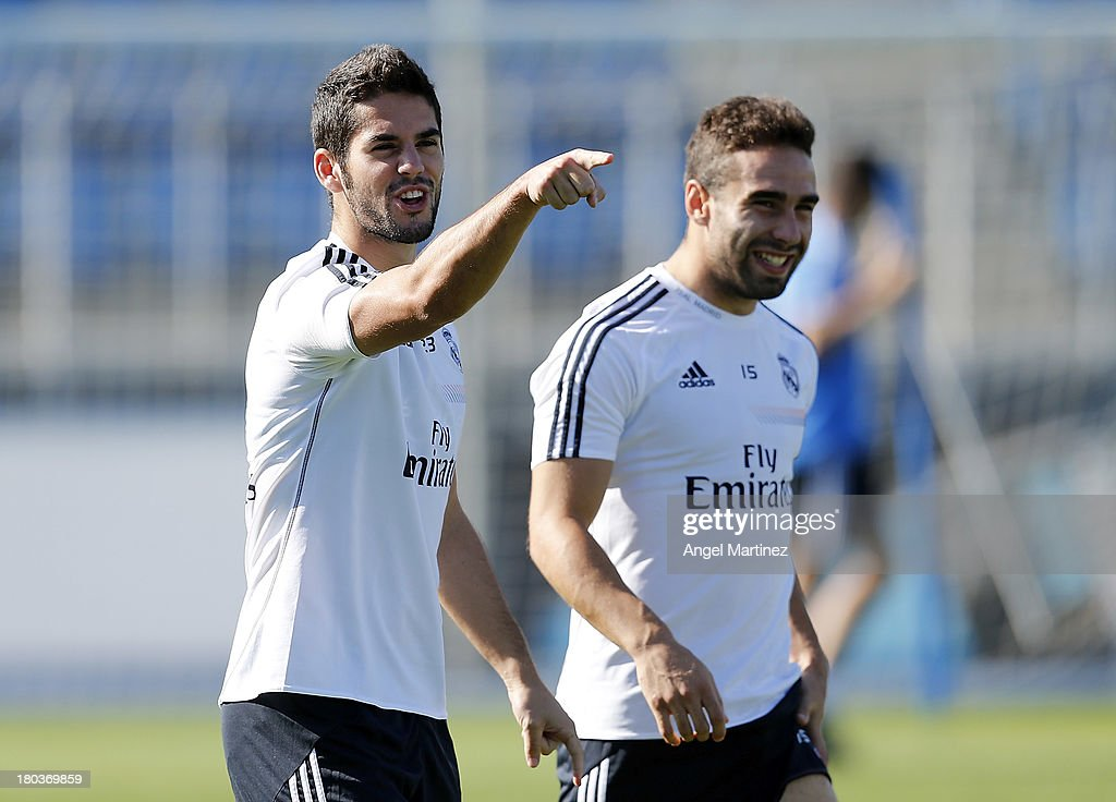 <a gi-track='captionPersonalityLinkClicked' href=/galleries/search?phrase=Isco&family=editorial&specificpeople=5848609 ng-click='$event.stopPropagation()'>Isco</a> (L) and Daniel Carvajal of Real Madrid joke during a training session at Valdebebas training ground on September 12, 2013 in Madrid, Spain.
