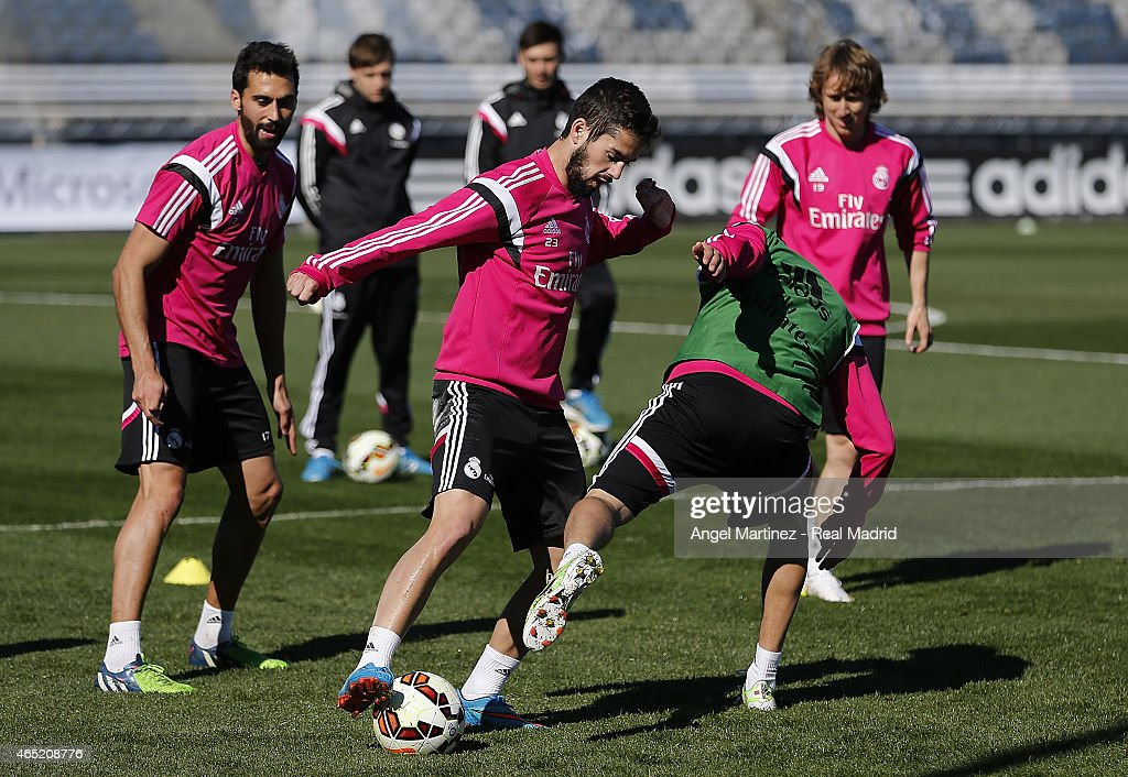 Isco (2L) and Fabio Coentrao of Real Madrid in action during a training session at Valdebebas training ground on March 4, 2015 in Madrid, Spain.