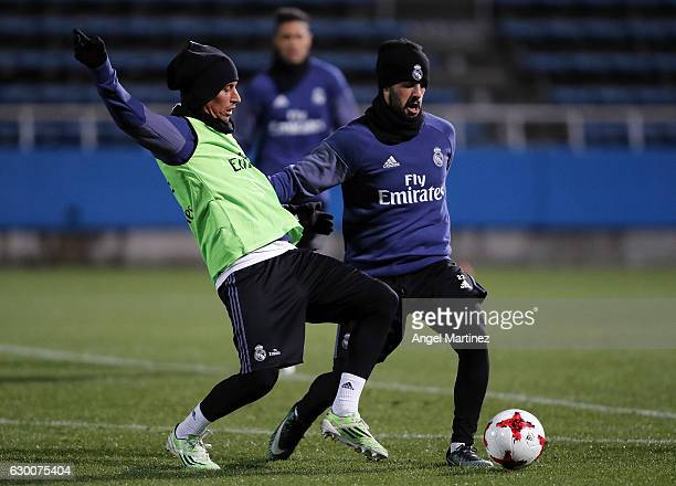 Isco and Fabio Coentrao of Real Madrid in action during a training session at Mitsuzawa Football Stadium on December 16 2016 in Yokohama Japan