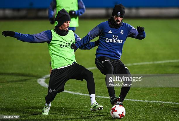 Isco and Fabio Coentrao of Real Madrid in action during a training session at Mitsuzawa Football Stadium in Yokohama Japan on December 16 2016