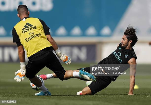 Isco and Kiko Casilla of Real Madrid in action during a training session at Valdebebas training ground on September 8 2017 in Madrid Spain
