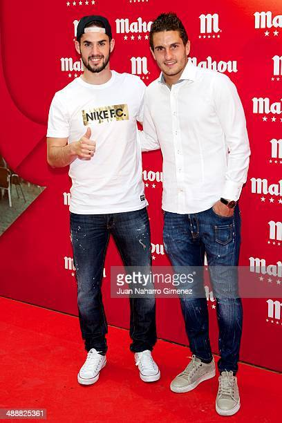 Isco and Koke attend new campaign 'Descubre Que Bien Sabe Ser De Mahou' presentation at MedialabPadro Madrid on May 8 2014 in Madrid Spain