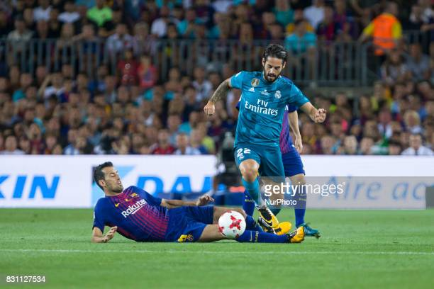 Isco and Sergio Busquets during the match between FC Barcelona Real Madrid for the first leg of the Spanish Supercup held at Camp Nou Stadium on 13th...