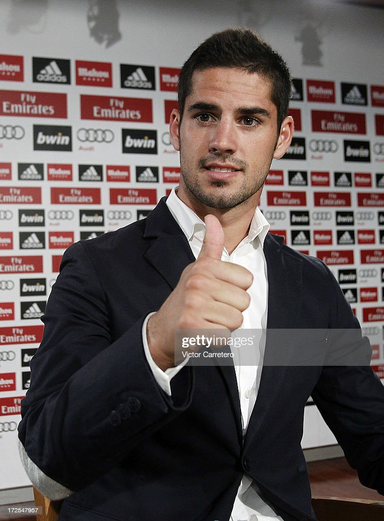 <a gi-track='captionPersonalityLinkClicked' href=/galleries/search?phrase=Isco&family=editorial&specificpeople=5848609 ng-click='$event.stopPropagation()'>Isco</a> attends a press conference after his official presentation as new Real Madrid player at the Santiago Bernabeu stadium on July 3, 2013 in Madrid, Spain.