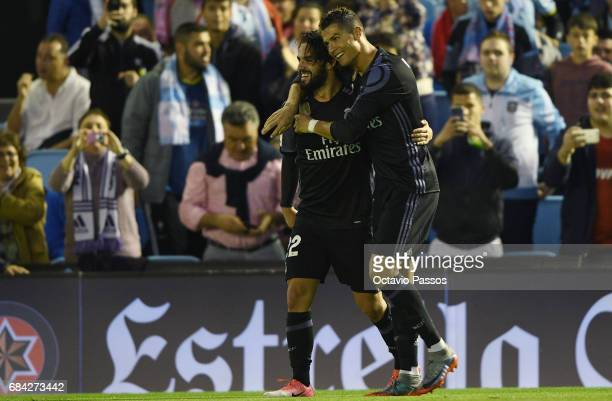 Isco celebrates with Cristiano Ronaldo of Real Madrid after scores the second goal against RC Celta during the La Liga match between Celta Vigo and...