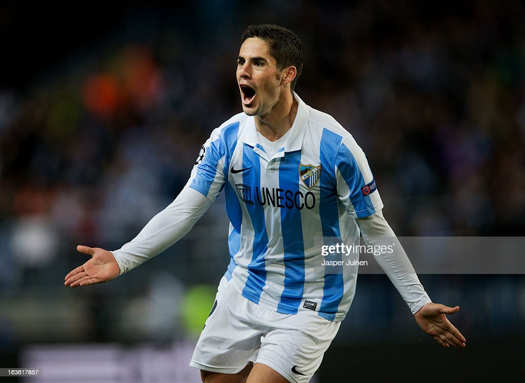 <a gi-track='captionPersonalityLinkClicked' href=/galleries/search?phrase=Isco&family=editorial&specificpeople=5848609 ng-click='$event.stopPropagation()'>Isco</a> of Malaga CF celebrates scoring his sides opening goal during the UEFA Champions League Round of 16 second leg match between Malaga CF and FC Porto at La Rosaleda Stadium on March 13, 2013 in Malaga, Spain.