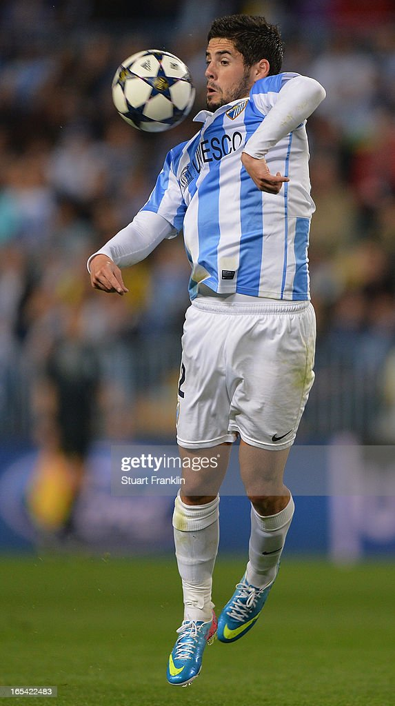 <a gi-track='captionPersonalityLinkClicked' href=/galleries/search?phrase=Isco&family=editorial&specificpeople=5848609 ng-click='$event.stopPropagation()'>Isco</a> of Malaga in action during the UEFA Champion League quarter final first leg match between Malaga CF and Borussia Dortmund at La Rosaleda Stadium on April 3, 2013 in Malaga, Spain.