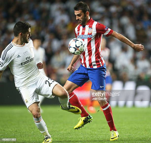 Isco of Real Madrid and Adrian Lopez Alvarez of Atletico Madrid in action during the UEFA Champions League final between Real Madrid and Atletico de...