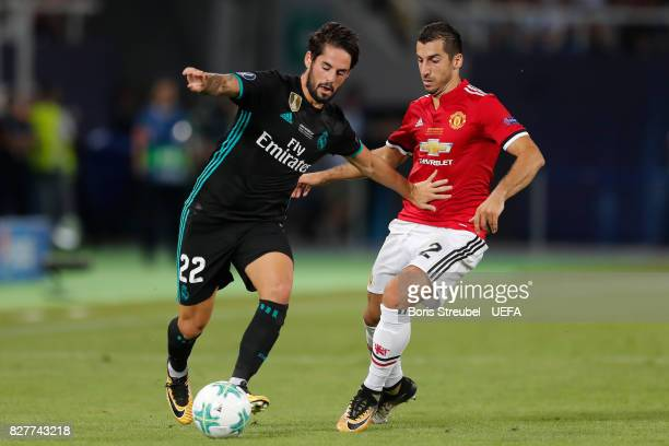 Isco of Real Madrid and Henrikh Mkhitaryan of Manchester United battle for possession during the UEFA Super Cup final between Real Madrid and...