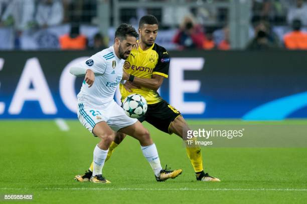 Isco of Real Madrid and Jeremy Toljan of Dortmund battle for the ball during the UEFA Champions League group H match between Borussia Dortmund and...