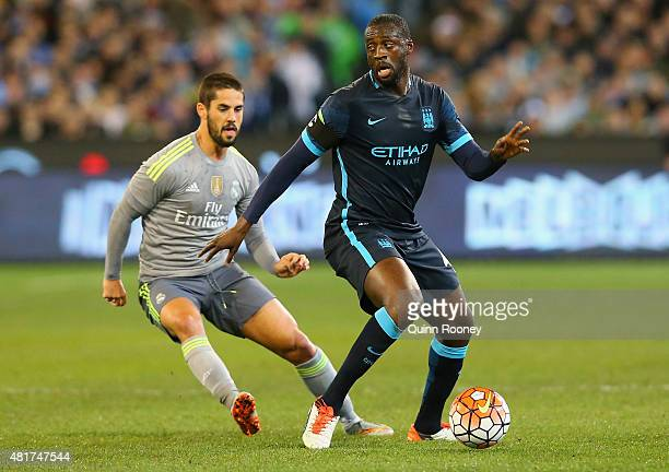 Isco of Real Madrid and Yaya Toure of Manchester City compete for the ball during the International Champions Cup match between Real Madrid and...