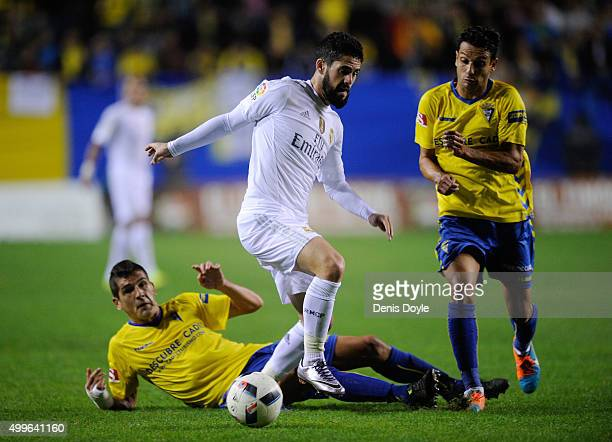 Isco of Real Madrid beats Jon Ander Garrido of Cadiz during the Copa del Rey Round of 32 First Leg match between Cadiz and Real Madrid at Ramon de...
